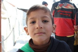 Young refugee boy in a tent settlement in Bekaa Valley © Carmen Andres